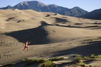 Woman running on sand dunes