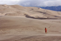 Person running on sand dunes