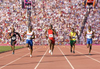 Runners racing on outdoor track