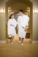 Couple in bathrobes at spa