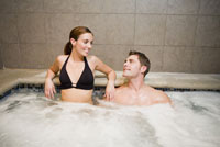 Couple smiling at each other in hot tub