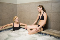Two women sitting in hot tub