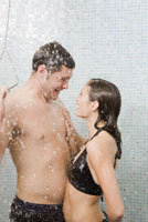 Couple in bathing suits taking shower