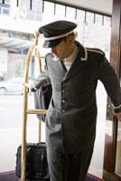 Bellhop pulling luggage cart