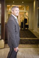 Businessman in hotel doorway