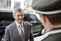 Businessman smiling at bellhop