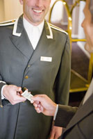 Businessman tipping bellhop