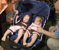 Father next to twins in stroller