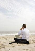 Businessman working on beach