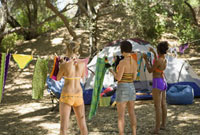Women hanging up laundry at campsite
