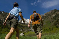 Couple hiking on mountain trail