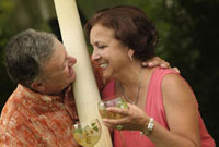 Hispanic couple drinking cocktails