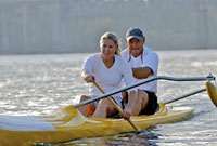 Couple rowing kayak