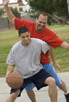 Hispanic men playing basketball