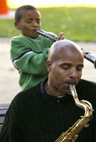 African father and son playing instruments