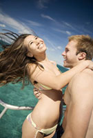 Couple hugging on boat