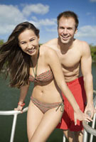 Couple in bathing suits on boat