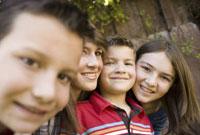 Smiling children posing outdoors