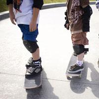 Children with skateboards in skate park