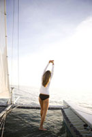 Woman standing on sailboat