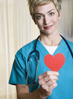 Female nurse holding heart-shaped cut out