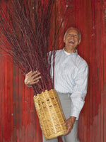 Man Holding Basket of Branches