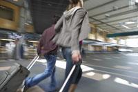 Couple Rushing Through Airport