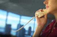 Businessman Using Telephone