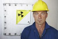 Worker by Hatch with Radioactive Symbol 11030016468| 写真素材・ストックフォト・画像・イラスト素材|アマナイメージズ