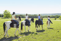 Women Horseback Riding