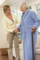 Woman Receiving Assistance with Standing 11030019632| 写真素材・ストックフォト・画像・イラスト素材|アマナイメージズ