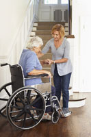 Woman in Wheelchair Receiving Assistance