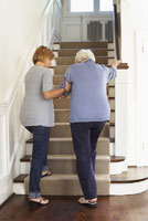Woman Receiving Assistance at Stairs