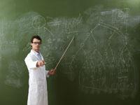 Teacher at Blackboard 11030020173| 写真素材・ストックフォト・画像・イラスト素材|アマナイメージズ