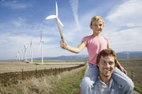 Father and Daughter with Wind Turbines 11030020725| 写真素材・ストックフォト・画像・イラスト素材|アマナイメージズ