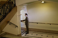 Businessmen Shaking Hands in Hallway