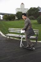 Businessman on Scooter 11030020983| 写真素材・ストックフォト・画像・イラスト素材|アマナイメージズ