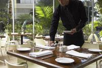 Waiter Setting Tables