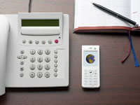 Telephone and Cellular Phone on Desk