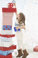 Girl Stacking Christmas Presents