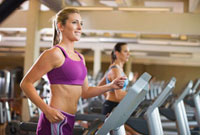 Women on Treadmills in Gym