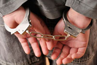 Close-up of Handcuffs on Boy's Wrists