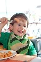 Boy Eating Pasta in Restaurant, Playa del Carmen, Mexico