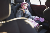 Portrait of Little Girl in Back Seat of Car