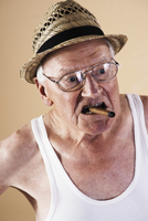 Portrait of Senior Man Smoking Cigar