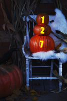 Front Porch Decorated for Halloween with Chair and Pumpkins