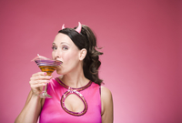 Portrait of Woman Wearing Devil Horns and Drinking a Martini