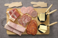 Overhead View of Meats and Cheese for Raclette on Cutting Bo