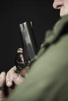 Close-up of Man with Gun, Mannheim, Baden-Wurttemberg, Germa