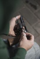 Close-up of Man Loading Bullets into Gun, Mannheim, Baden-Wu 11030036823| 写真素材・ストックフォト・画像・イラスト素材|アマナイメージズ